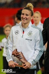 Anja Mittag and her FIFA Bronze Boot award won during the 2015 Women's World Cup.
