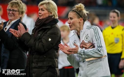 Anja Mittag cheering on Célia Šašić.
