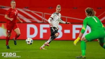 Simone Laudehr (GER) crosses the ball.