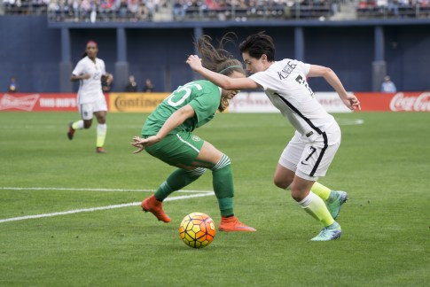 Meghan Klingenberg with the step-over and move to the endline.
