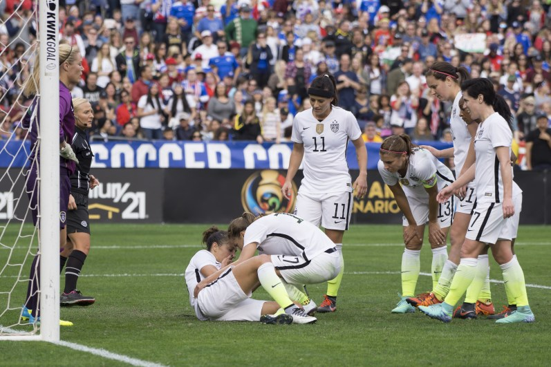 Teammates check on Carli Lloyd.