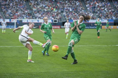 USA's Heather O'Reilly takes a shot while Ireland's Julie Ann Russell and Megan Campbell defend.