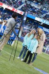 Christie Rampone with her daughters at a pregame ceremony honoring Rampone for her USWNT career.