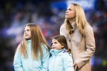 Christie Rampone and her daughters at a pregame ceremony honoring Rampone for her USWNT career.