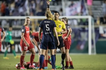 Sam Mewis recieves a yellow card (Shane Lardinois).