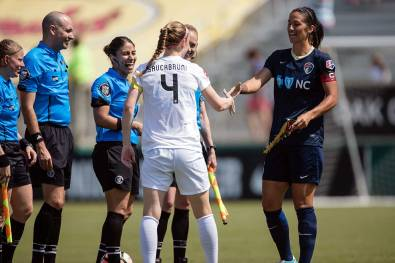 Captains' handshake. Becky Sauerbrunn (4) and Abby Erceg. (Shane Lardinois)