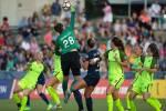 Seattle's Haley Kopmeyer punches the ball. (Shane Lardinois)