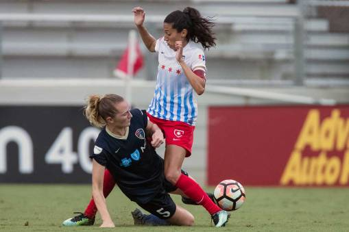 We're sensing a pattern here, Sam. Sam Mewis and Christen Press vying for the ball. (Shane Lardinois)