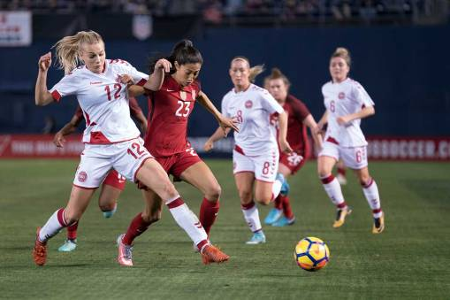 Stine Larsen and Christen Press vie for the ball. (Manette Gonzales)