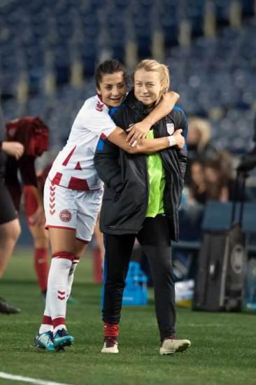 Former Portland Thorns teammates Nadia Nadim (Denmark) and Emily Sonnett (USA). (Manette Gonzales)