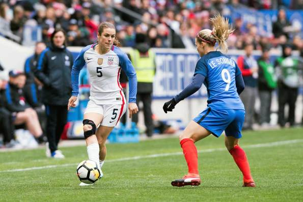 USA's Kelley O'Hara takes on France's Eugénie Le Sommer during the 2018 SheBelieves Cup. (Monica Simoes)