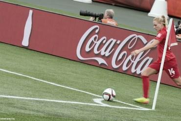 England's Alex Greenwood taking a corner kick. (IQRemix from Canada)