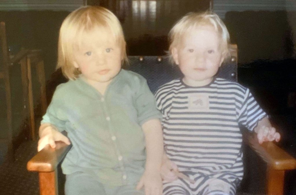 Beth England (in stripes) and twin sister Laura as kids. (England family)