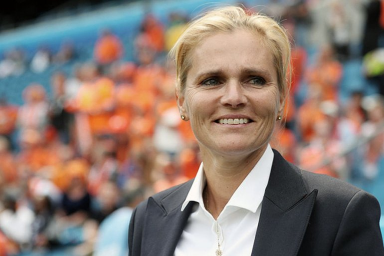 Head coach of The Netherlands, Sarina Wiegman smiling on the sideline. (The FA)