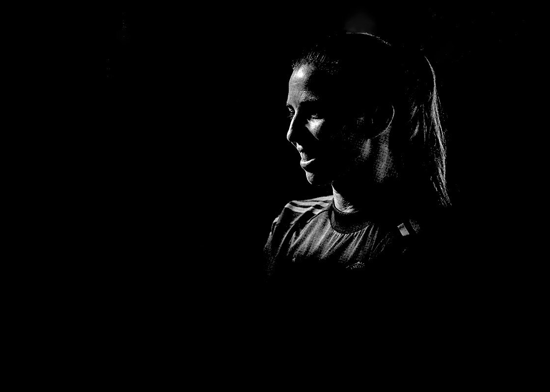 Tobin Heath in black and white silhouette and Manchester United kit. (Manchester United)