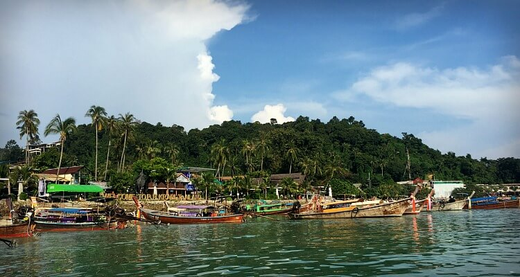 Busy resorts and long boats in Phi Phi Islands