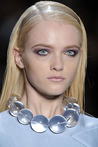 Michael Kors side-parted hairstyle