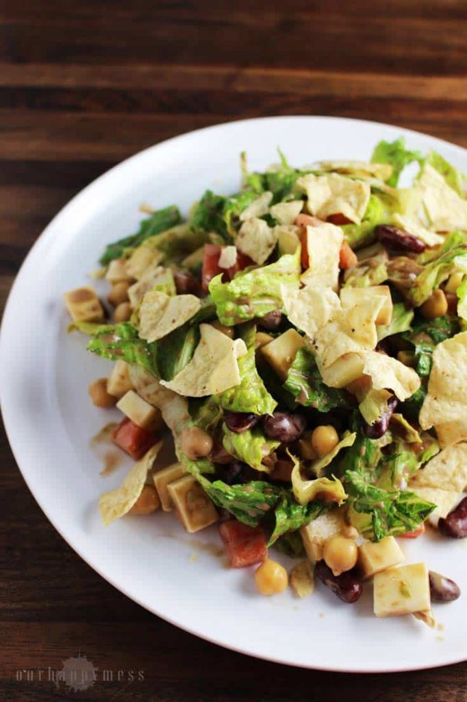 This chopped salad, with two kinds of beans, cubes of cheese, crunchy greens, and a tangy balsamic vinaigrette makes an easy weeknight meal.