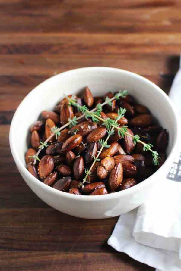 These super simple herbed roasted almonds from The Art of Simple Food by Alice Waters of Chez Panisse are perfect to serve with drinks. They're also a great for healthy snacking anytime.#ChezPanisse #herbedalmonds #roastednuts #healthysnack