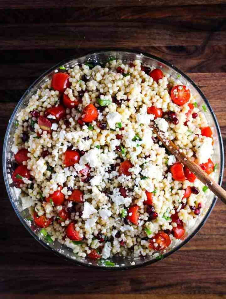 Overhead view of a large bowl of Mediterranean Israeli couscous salad