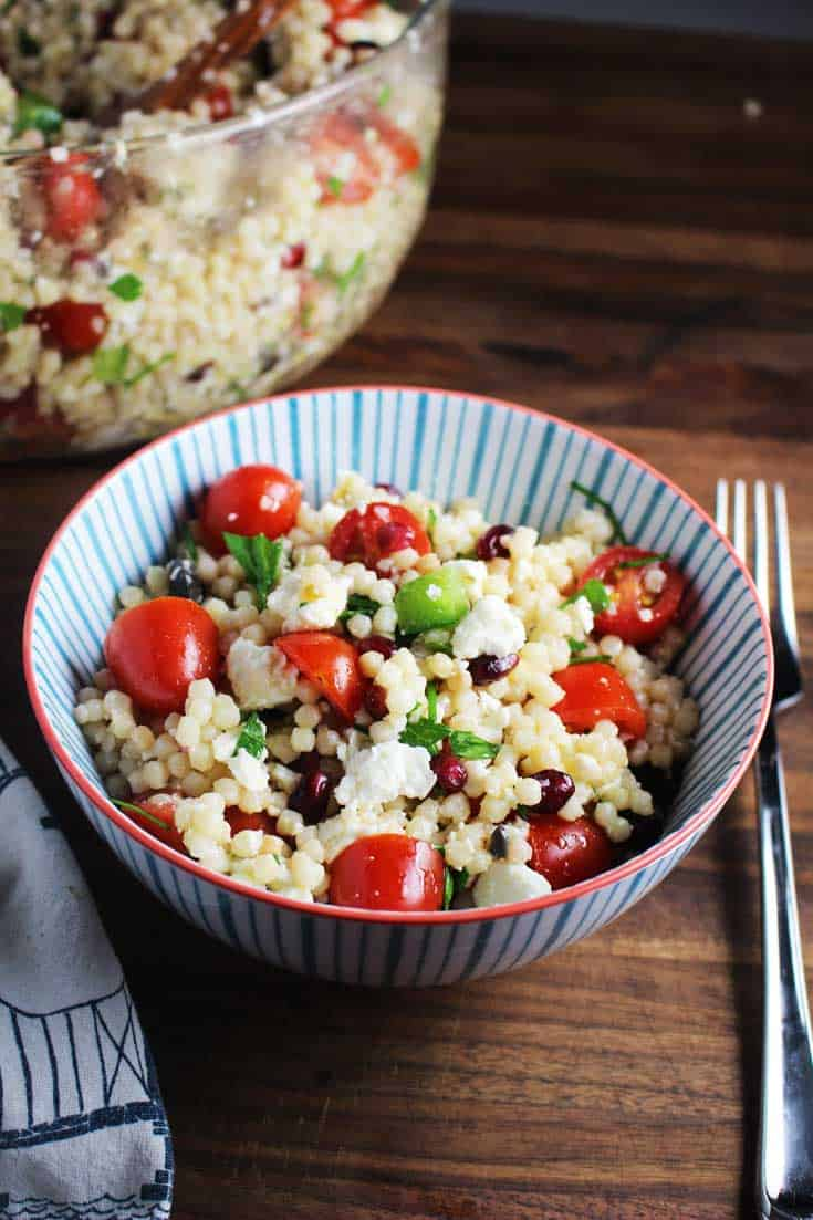 This Mediterranean Israeli couscous salad is an easy make-ahead salad that makes a great side, lunch, or potluck dish. #potluck #mediterraneansalad #Israelicouscous