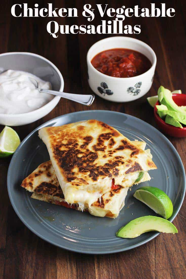 These chicken quesadillas, made with fajita-style chicken, green and red peppers, onions, and lots of gooey cheese, are a quick and easy way to satisfy your Tex-Mex cravings. A super quick weeknight dinner recipe, or a perfect Mexican meal for Cinqo de Mayo! #Mexicanfood #quesadillas #grilledcheese #chicken #Mexican #tortillas #easydinnerrecipes #easydinner #cinqodemayo