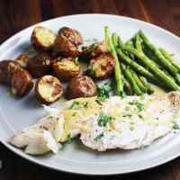 fish, green beans and potatoes on a plate for a sheet pan dinner