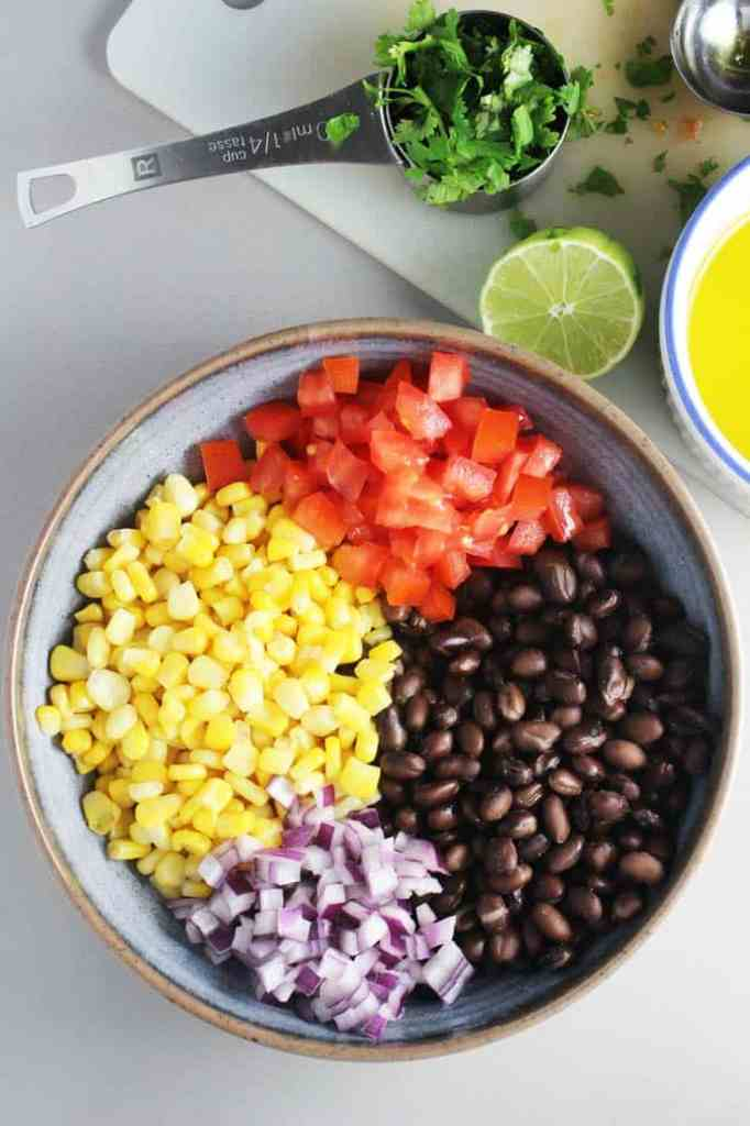 ingredients for black bean and corn salsa in a bowl for blackened fish taco recipe