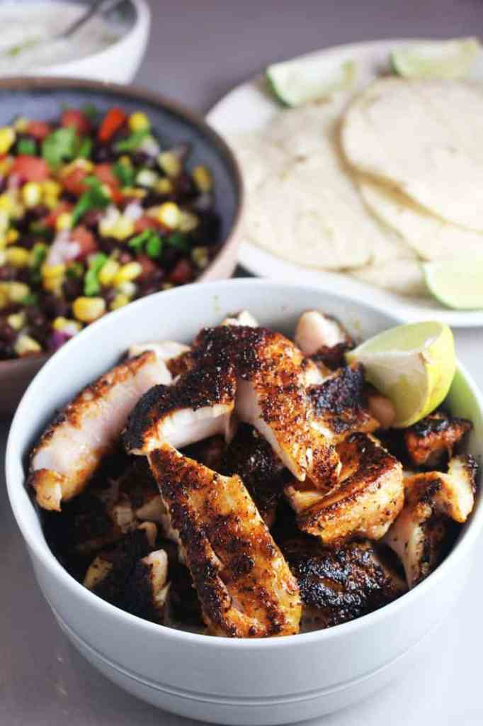Blackened fish with taco fixings for blackened fish tacos