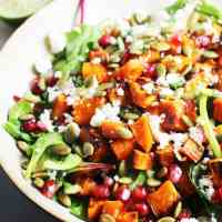 Roasted sweet potato salad in a bowl with kale