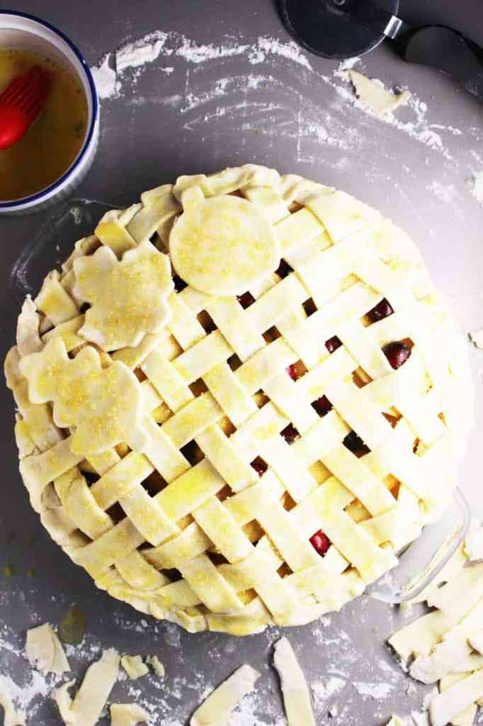 Unbaked apple cranberry pie with a lattice crust