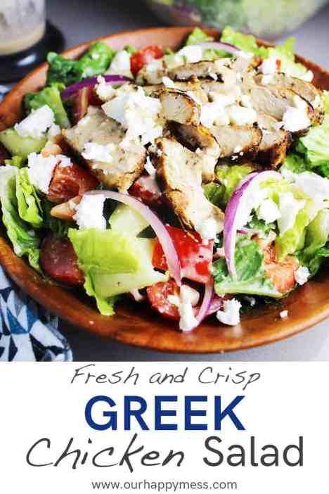 Greek chicken salad in a wooden bowl