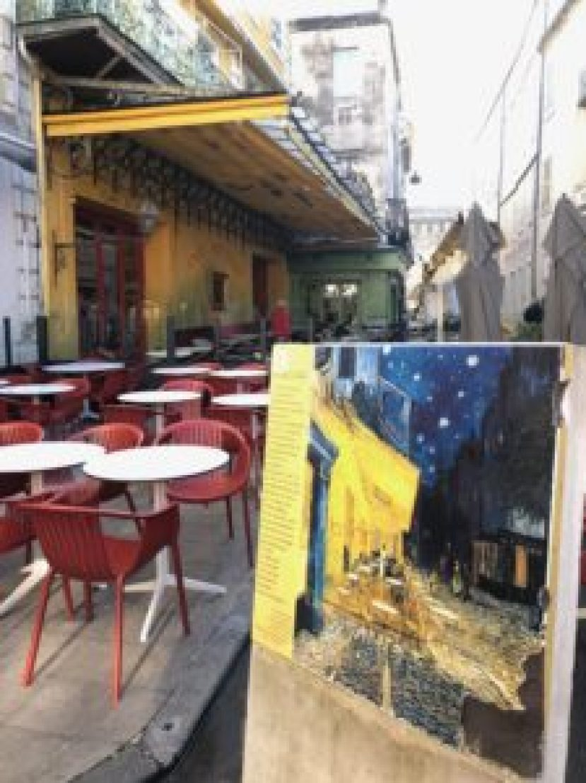 Easel showing van Gogh's painting Cafe at Night in front of the actual cafe