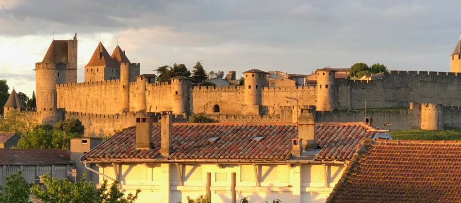 View of medieval walled city from balcony of apartments for rent in Carcassonne