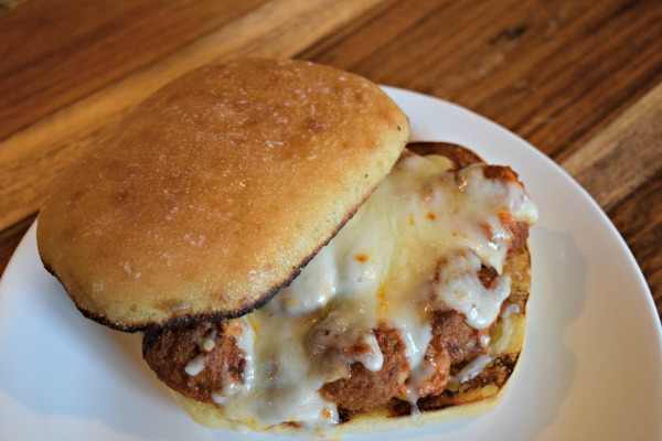 A healthy take on beef meatballs by subbing out for Turkey! These are super easy to prep before you leave in the morning since the meatballs cook in a slow cooker. Click to see the recipe!