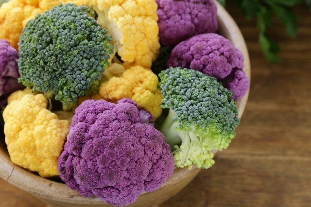 different cauliflower broccoli green yellow and purple