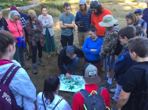 Eatonville middle schoolers circle around a map