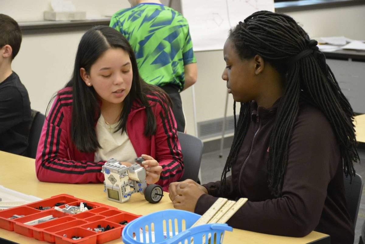 two girls building a robot