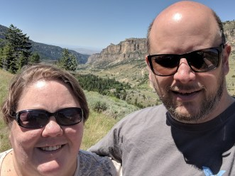 Jason and Barb overlooking the canyon of the Big Horn mountain range that US Highway 16 travels