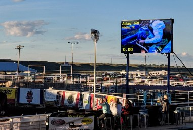 Extreme bull riding at the Cody Rodeo, big screen at the North end of the arena