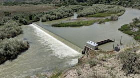The dam funnels water to an underground tunnel system and water is distributed to farms in the area for irrigation
