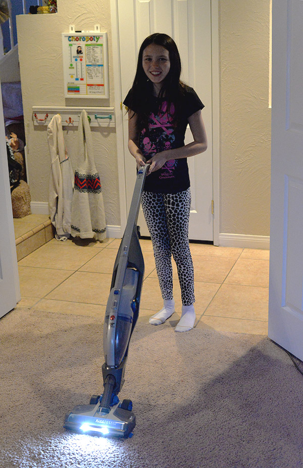 Kid using cordless vacuum friendly Hoover