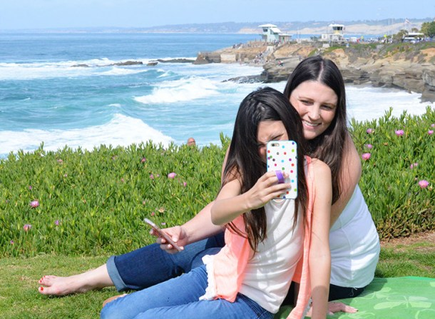 mom and daughter taking selfie