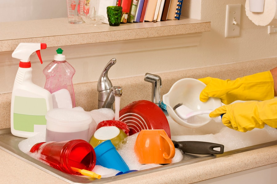 A sink full of soapy water and dishes