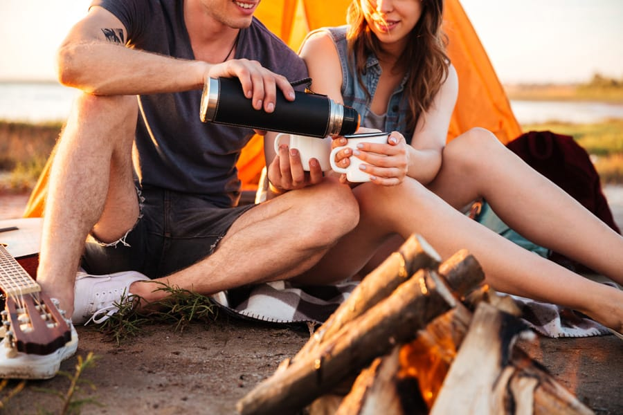 couple camping in front of tent