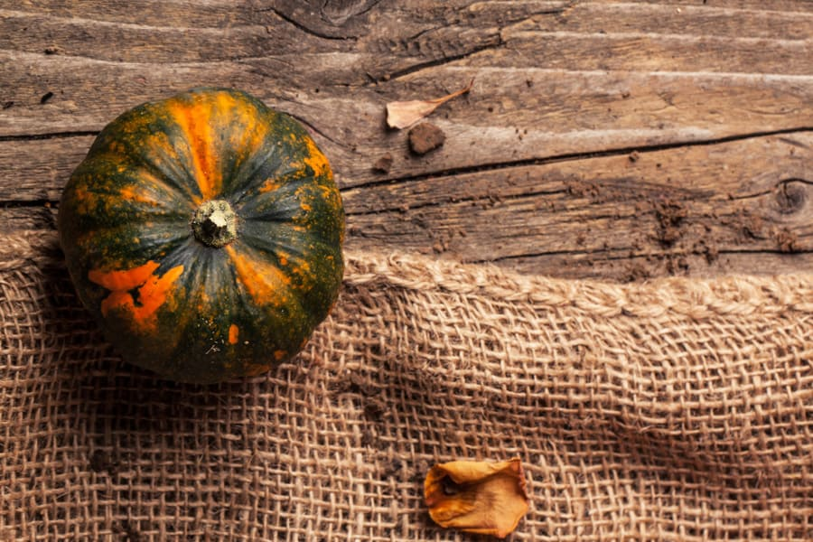 a pumpkin on a wooden background