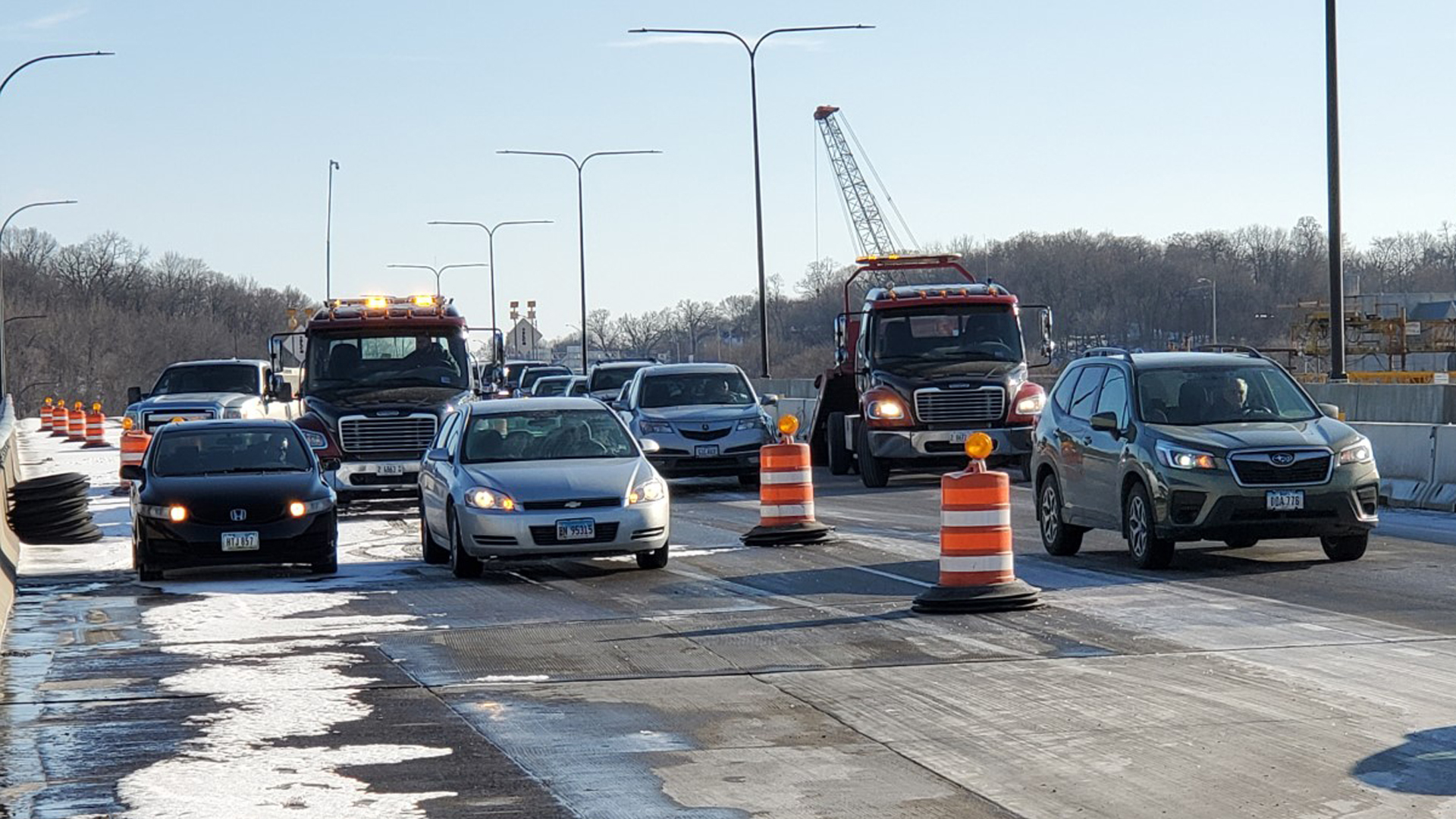 Tow trucks clear cars from an accident on I-74 in Moline, Illinois on Febraury 15 (photo: Ryan Risky, OurQuadCities.com)