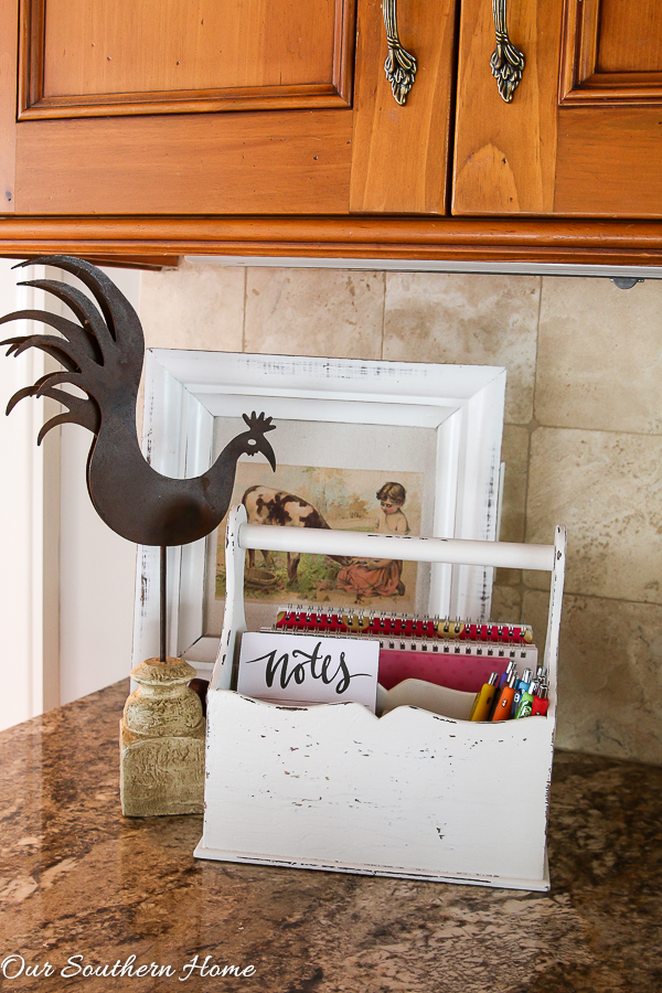 Thrift store caddy gets a farmhouse style makeover that can be used in many ways! Spray paint is your friend!