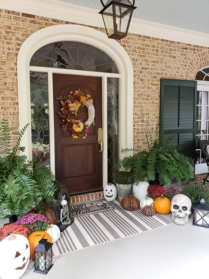 front door with mums and pumpkins