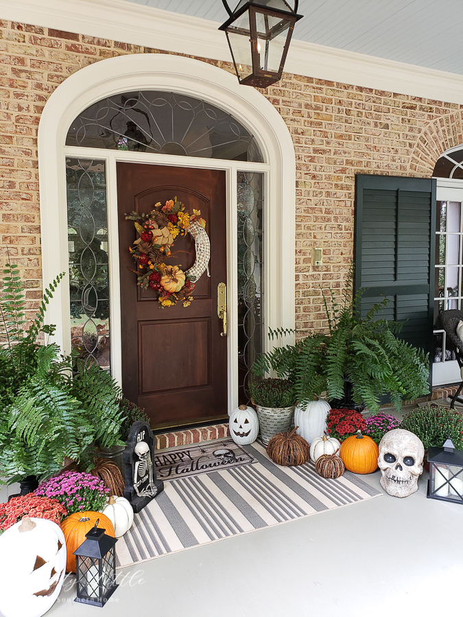 front door with mums and pumpkins